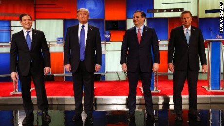 Republican presidential candidates, Sen. Marco Rubio, R-Fla., businessman Donald Trump, Sen. Ted Cruz, R-Texas, and Ohio Gov. John Kasich take the stage before a Republican presidential primary debate at Fox Theatre, Thursday, March 3, 2016, in Detroit. (AP Photo/Paul Sancya)