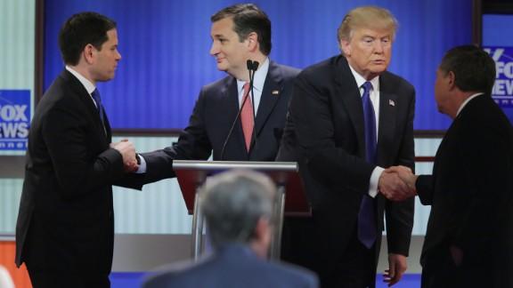 Republican presidential candidates (Lto R) Sen. Marco Rubio (R-FL), Sen. Ted Cruz (R-TX),  Donald Trump and Ohio Gov. John Kasich greet each following a debate sponsored by Fox News at the Fox theatre on March 3, 2016 in Detroit, Michigan.