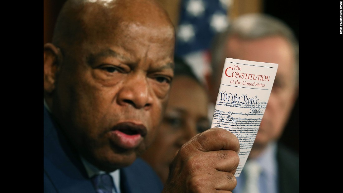 "U.S. Rep. John Lewis holds a copy of the Constitution during a news conference with Senate Democrats and members of the Congressional Black Caucus on Thursday, March 3. They are urging Senate Republicans not to block confirmation hearings for President Obama's next Supreme Court nominee. The GOP has said <a href=""http://www.cnn.com/2016/02/23/politics/joe-biden-supreme-court-senate-republicans/"" target=""_blank"">it wants to wait </a>until the next President is elected."