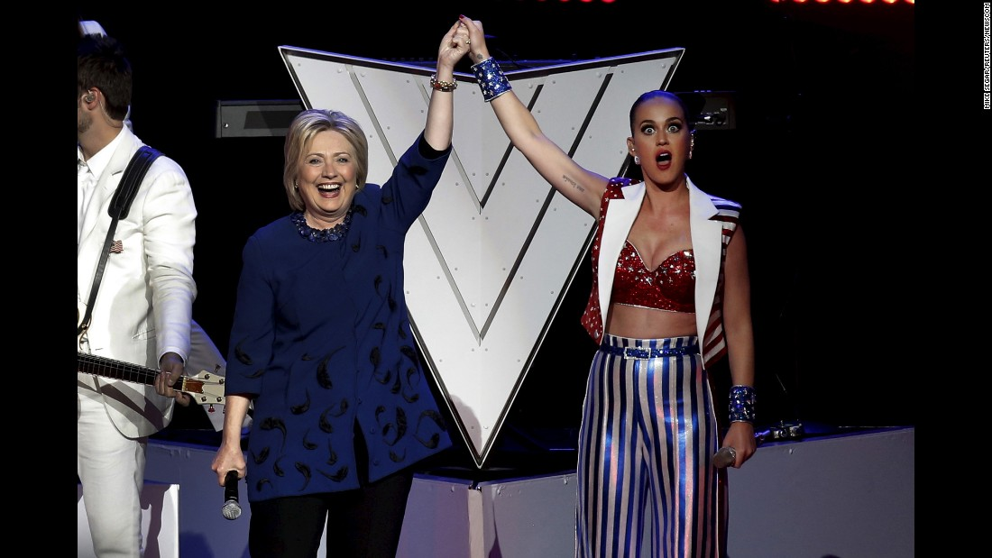 Singer Katy Perry raises Hillary Clinton's arm at the end of a fundraising concert in New York on Wednesday, March 2.