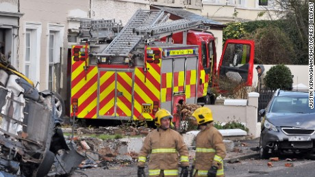Thieves broke into a Northern Ireland fire station and went on wild joyride in a stolen fire engine, damaging houses and cars.