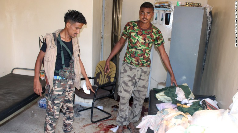 Yemeni pro-government fighters, loyal to exiled Yemeni President Abedrabbo Mansour Hadi, inspect an elderly care home in Yemen's main southern city of Aden after it was attacked by gunmen on March 4, 2016.Four gunmen stormed the facility housing dozens in Aden's Sheikh Othman district, killing a guard before tying up and shooting employees, the officials told AFP.