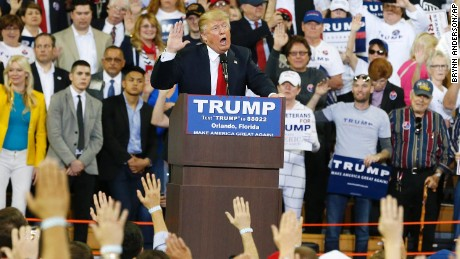 Republican presidential candidate Donald Trump asks the crowd to take a pledge to promise to vote for him during a campaign rally on Saturday, March 5, in Orlando, Florida.