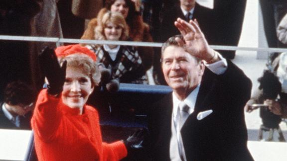 Reagan and the first lady wave immediately following his swearing in.