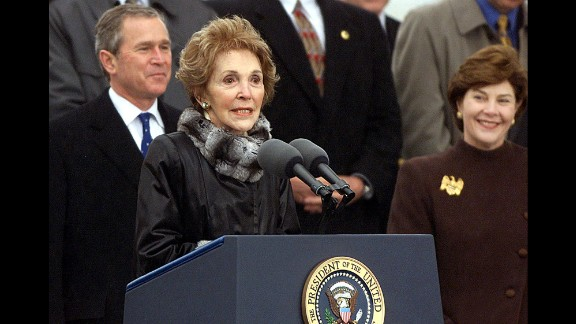 Nancy Reagan speaks as President George W. Bush and first lady Laura Bush look on at the christening ceremony of the aircraft carrier USS Ronald Reagan on March 4, 2001, in Newport News, Virginia.