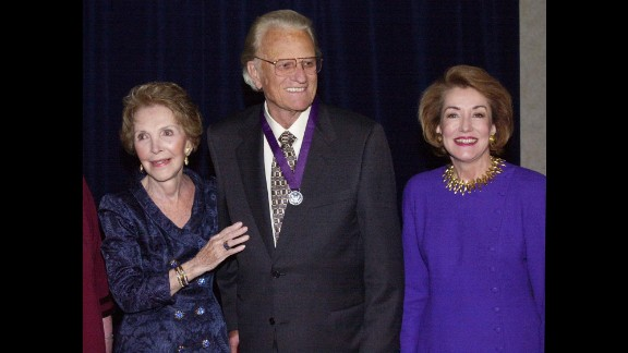 "Reagan and Elizabeth Dole, right, pose with the Rev. Billy Graham after honoring him with the Ronald Reagan Freedom Award in recognition of his ""monumental and lasting contribution to the cause of religious freedom"" during a ceremony on April 5, 2000, in Beverly Hills, California."