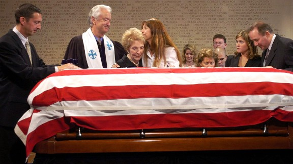 Ron Reagan, Michael Wenning, Nancy Reagan, Patti Davis, Ashley Reagan and Michael Reagan pay their respects over the casket that contains the body of former President Ronald Reagan following the memorial service  on June 7, 2004, at the Ronald Reagan Presidential Library in Simi Valley, California.