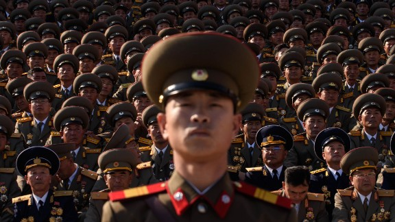 A North Korean soldiers stands before spectators during a mass military parade at Kim Il-Sung square in Pyongyang on October 10, 2015. North Korea was marking the 70th anniversary of its ruling Workers