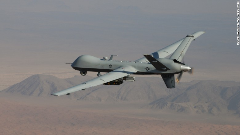 An MQ 9 Reaper Armed With GBU 12 Paveway II Laser Guided Munitions