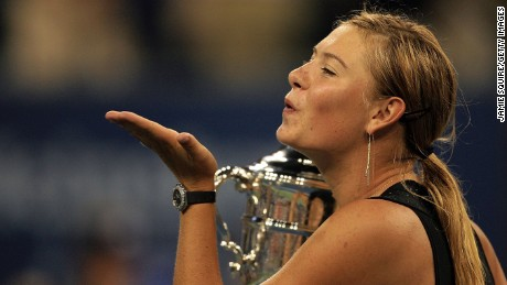 Maria Sharapova of Russia blows kisses after receiving the championship trophy following her straight set victory over Justine Henin-Hardene of Belgium in the final of the U.S. Open at the USTA Billie Jean King National Tennis Center in Flushing Meadows Corona Park on September 9, 2006.