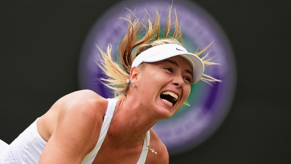 Maria Sharapova of Russia serves in her Ladies' Singles Fourth Round match against Zarina Diyas of Kazakhstan during day seven of the Wimbledon Lawn Tennis Championships at the All England Lawn Tennis and Croquet Club on July 6, 2015 in London, England.