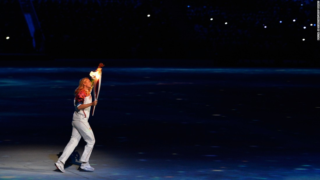 Sharapova carries the Olympic torch in Sochi, Russia, during the opening ceremony for the 2014 Winter Olympics.