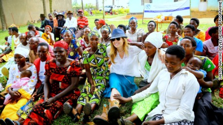 UNDP Goodwill Ambassador Connie Britton visits with women in Rwanda in June 2015.