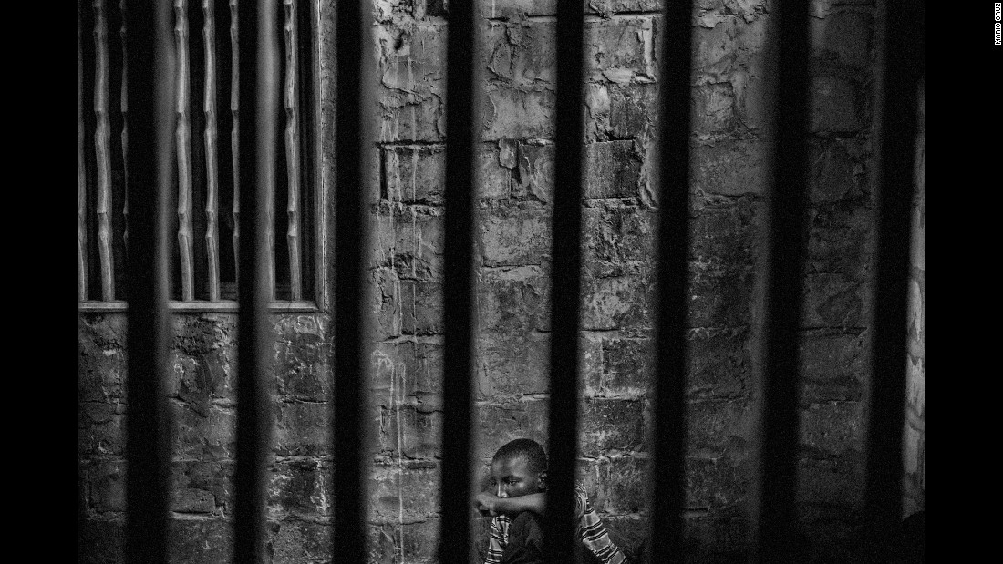 Abdoulaye, 15, is imprisoned at a Quranic school in Thies, Senegal, in May. The rooms have windows with security bars to keep the talibés, or students, from running away. Photographer Mario Cruz gained rare access to some corrupt Quranic schools in Senegal where students are being held against their will and forced to work for teachers.