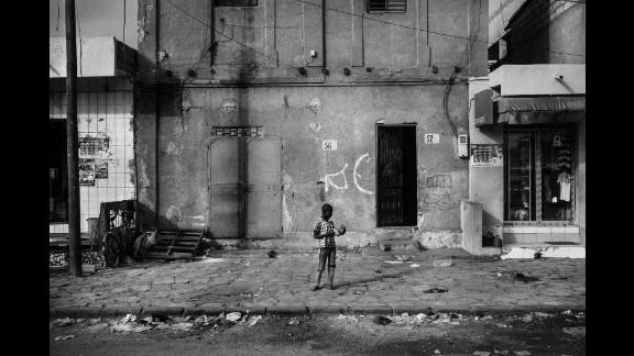 A talibé begs on the outskirts of Dakar.