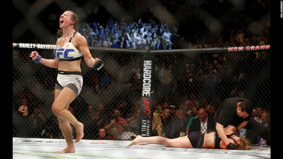 Miesha Tate celebrates after she defeated Holly Holm to win the UFC bantamweight title on Saturday, March 5. Holm submitted to a rear-naked choke in the fifth round.
