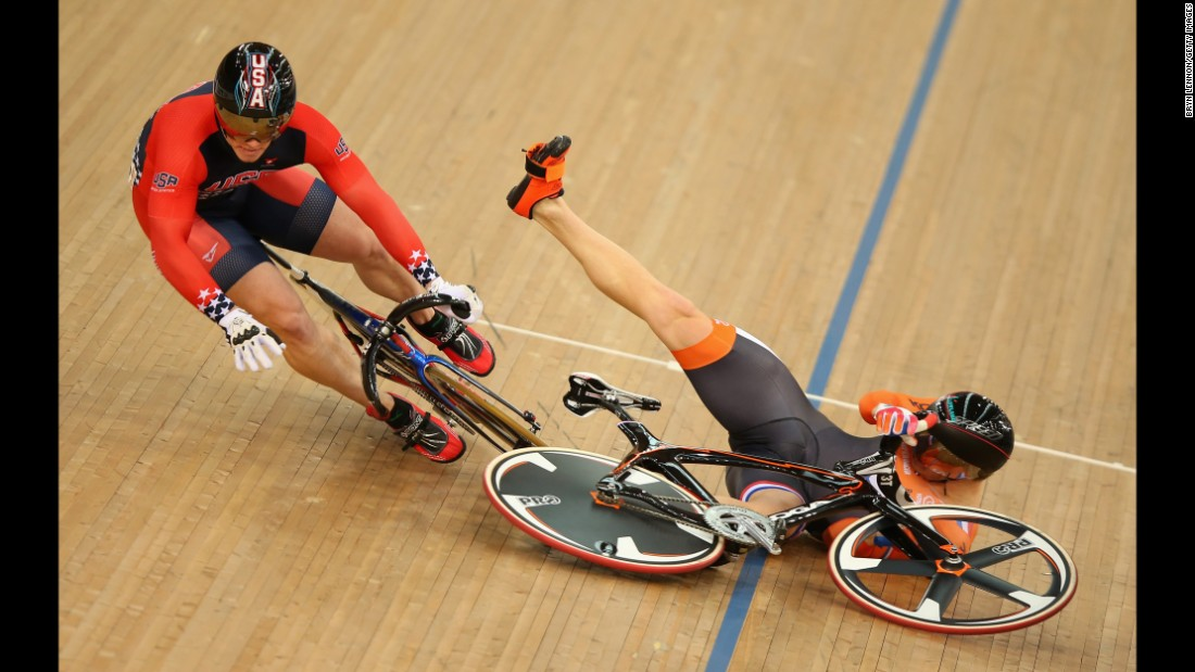 Dutch cyclist Matthijs Buchli, left, crashes into American Matthew Baranoski during a keirin race Sunday, March 6, at the Track Cycling World Championships.