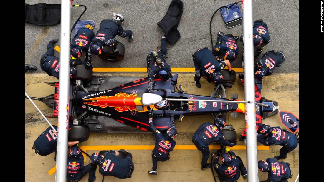 Members of the Red Bull Racing Team take part in a pit-stop practice session during winter testing in Montmelo, Spain, on Wednesday, March 2. The Formula One season begins in Australia on March 20.