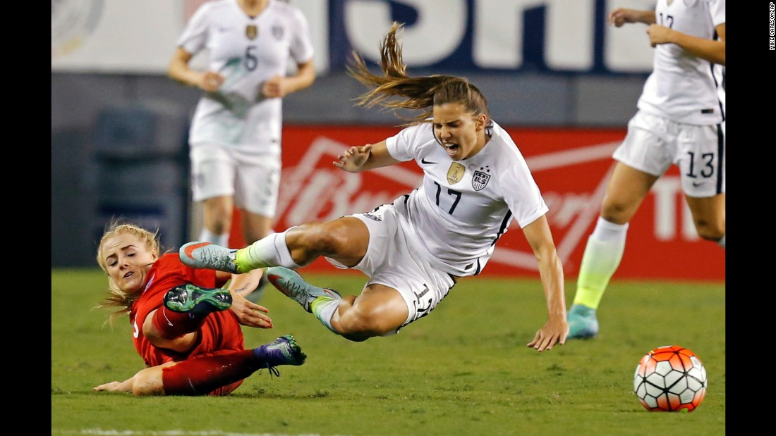 U.S. midfielder Tobin Heath reacts to a tackle by England's Alex Greenwood during a match in Tampa, Florida, on Thursday, March 3.  The Americans won 1-0 in the SheBelieves Cup, a four-team tournament that ends March 9.