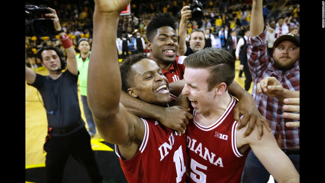 Indiana guard Yogi Ferrell, left, celebrates with teammate Harrison Niego, right, after the Hoosiers defeated Iowa and clinched the Big Ten regular-season title on Tuesday, March 1. Ferrell, the team's starting point guard, finished with 20 points.