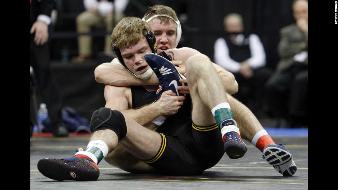 Penn State's Zain Retherford is wrapped around Iowa's Brandon Sorensen during the 149-pound final at the Big Ten Championships on Sunday, March 6. Retherford won the match and was named the conference's wrestler of the year.