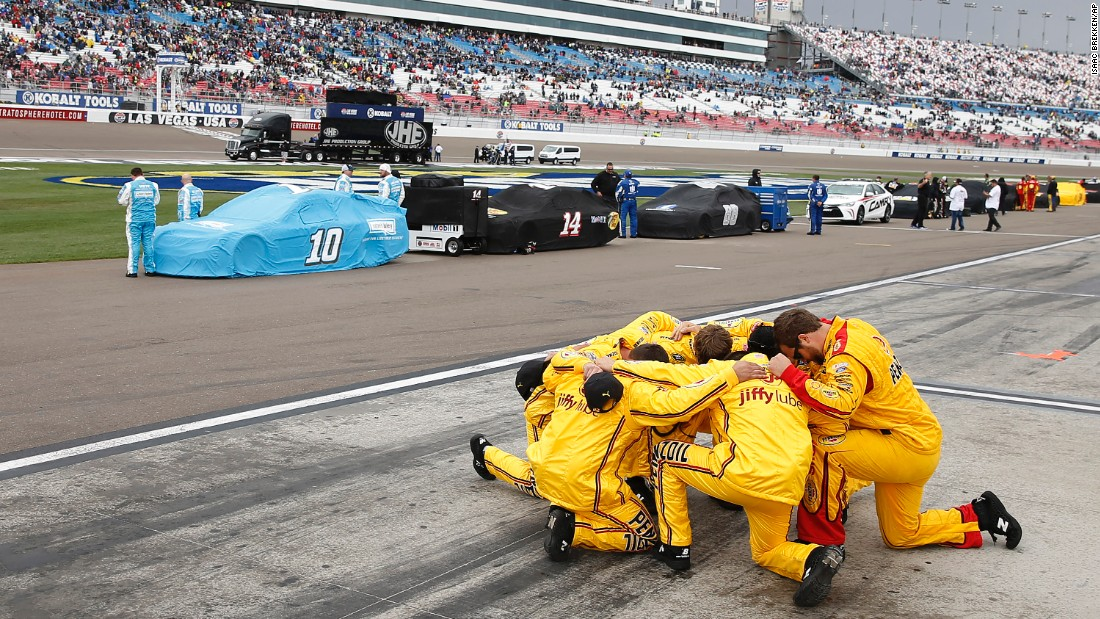 A NASCAR pit crew kneels in prayer before the Sprint Cup race in Las Vegas on Sunday, March 6.