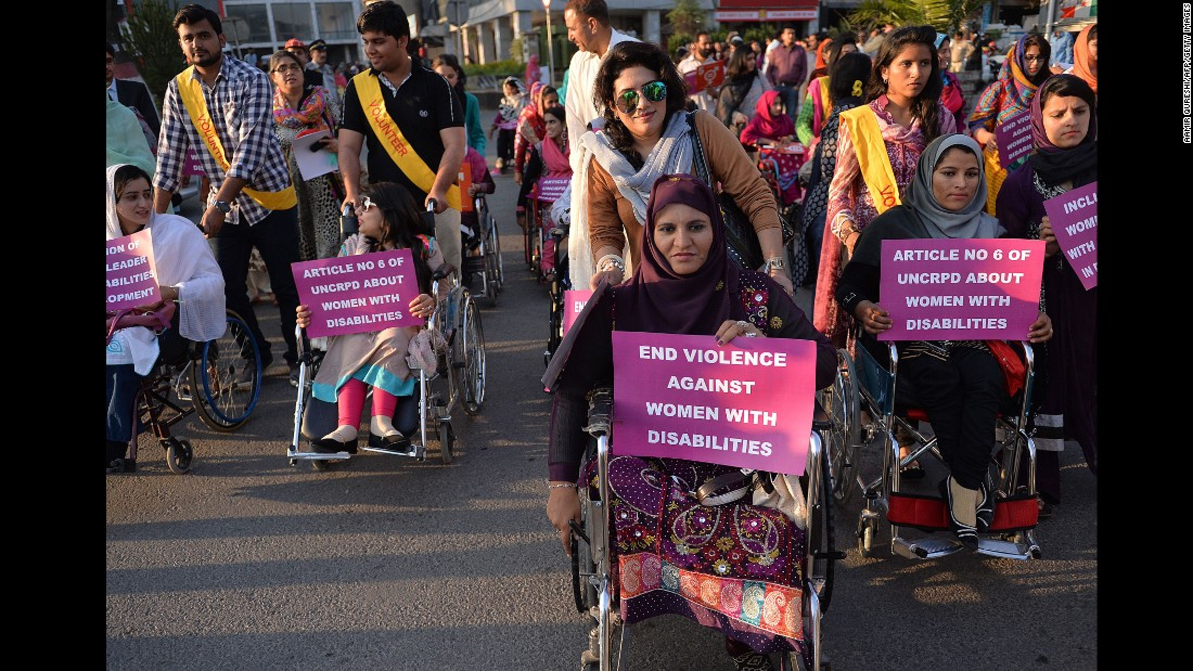 Pakistani civil society activists hold placards as they march in a rally to mark International Women's Day in Islamabad on March 8.