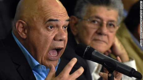 "The secretary general of the Democratic Unity Roundtable (MUD), Jesus ""Chuo"" Torrealba (L), and the president of the Venezuelan National Assembly, Henry Ramos Allup , offer a press conference in Caracas on March 8, 2016. Venezuela's opposition called for the ""largest movement that has ever existed"" to oust President Nicolas Maduro, vowing to pursue all means to force him from power. The opposition, which has been on a collision course with Maduro since winning control of the legislature in December, spent weeks deciding on its strategy to remove the deeply unpopular socialist president -- whether through a referendum, a constitutional amendment or the drafting of a new constitution.  AFP PHOTO / JUAN BARRETO / AFP / JUAN BARRETO        (Photo credit should read JUAN BARRETO/AFP/Getty Images)"