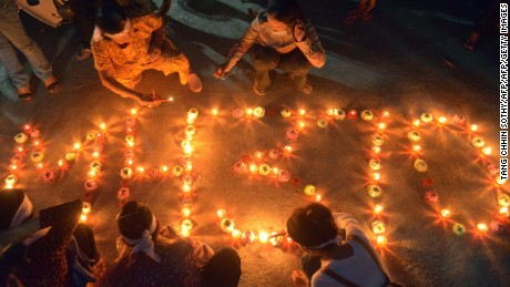 Cambodian residents of a community light candles as they pray for the missing Malaysia Airlines flight MH370 at their village in Phnom Penh on March 17, 2014. An investigation into the pilots of missing Malaysia Airlines flight 370 intensified on March 17 after officials confirmed that the last words spoken from the cockpit came after a key signalling system was manually disabled.  AFP PHOTO/ TANG CHHIN SOTHY        (Photo credit should read TANG CHHIN SOTHY/AFP/Getty Images)
