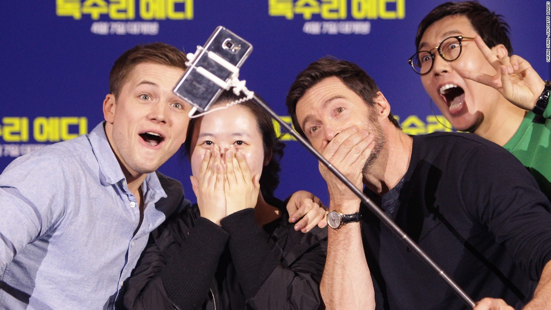 "Hugh Jackman uses a selfie stick as he and fellow actor Taron Egerton, left, take a photo with a fan in Seoul, South Korea, on Tuesday, March 8. They were promoting their new film ""Eddie the Eagle."" <a href=""http://www.cnn.com/2016/03/02/living/gallery/look-at-me-selfies-0301/index.html"" target=""_blank"">See 22 selfies from last week</a>"