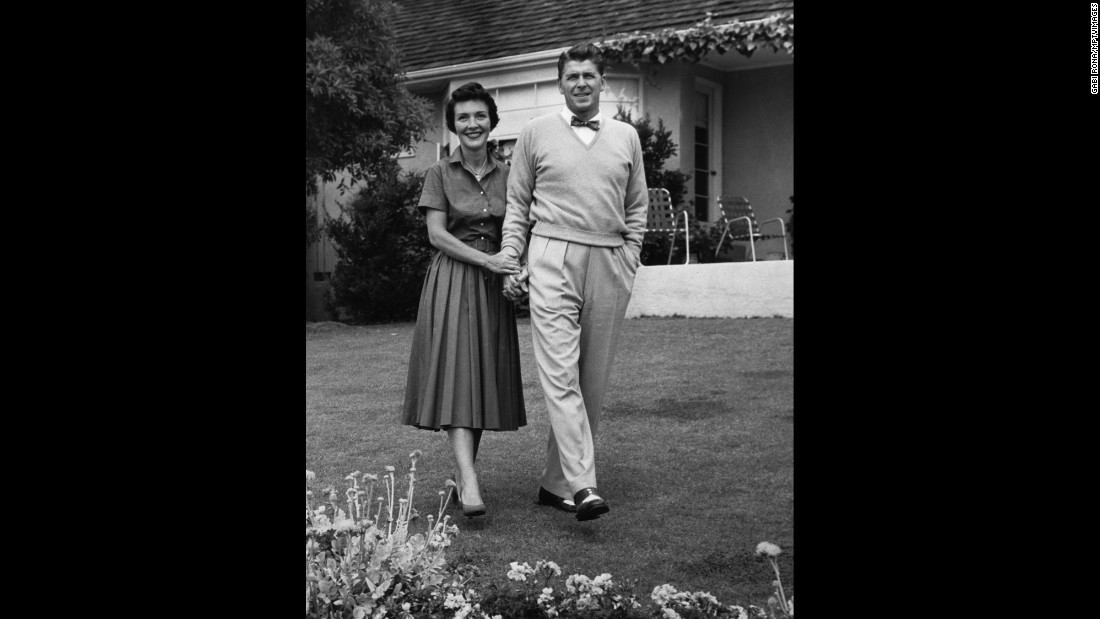 The Reagans pose for a photo at their home in Los Angeles in 1955. The actors met in 1949 and were married in 1952.