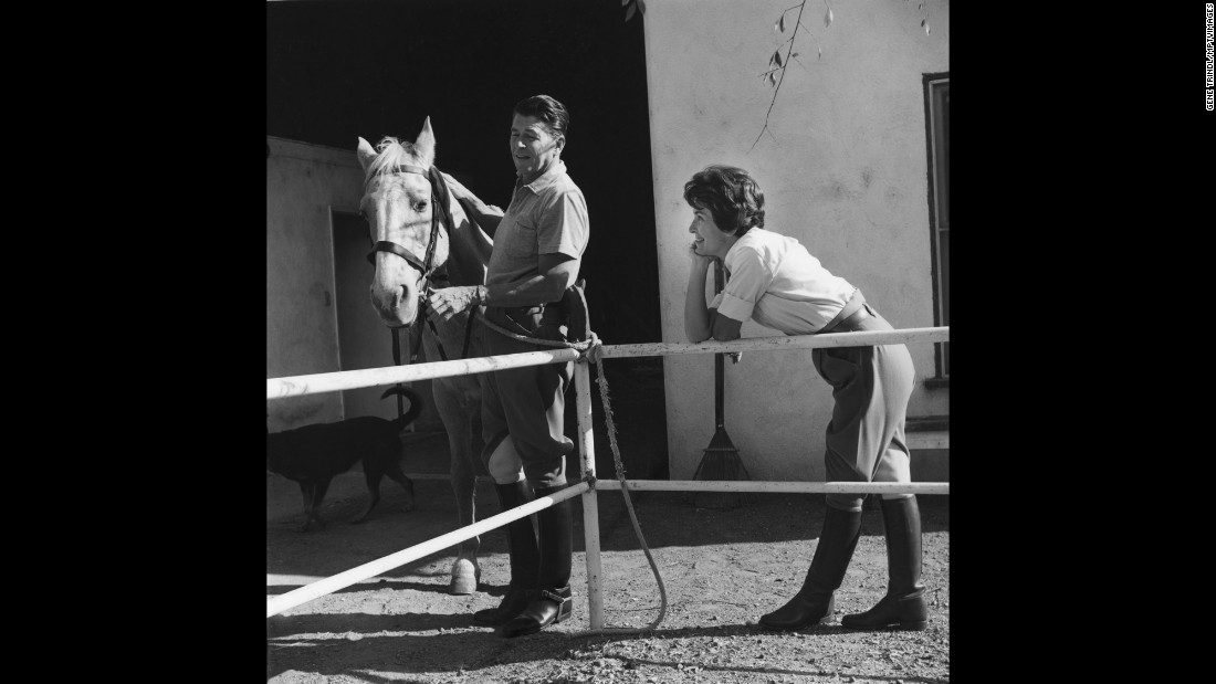 Ronald attends to a horse at their ranch in Agoura, California, in 1966. A year later, he became governor of California.