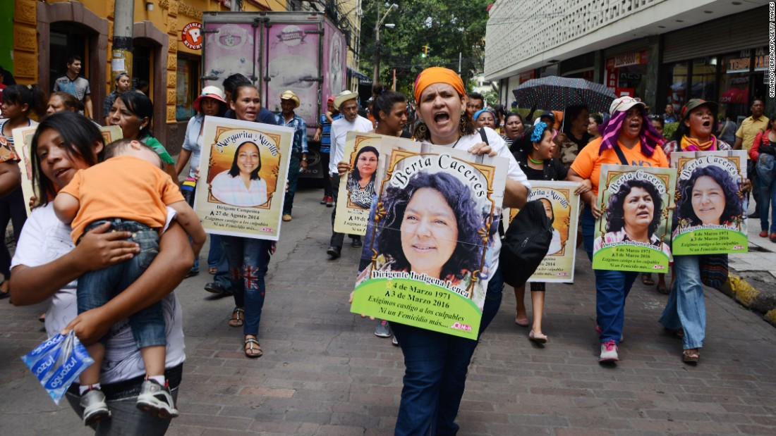 "Marchers carry posters bearing the face of slain environmentalist Berta Caceres during a demonstration in Tegucigalpa, Honduras, on March 8. Caceres, a member of the Lenca indigenous group and co-founder of the Council of Indigenous Peoples of Honduras, led a successful campaign against one of Central America's biggest hydropower projects, the Agua Zarca cascade of four giant dams in the Gualcarque River basin. <a href=""http://www.cnn.com/2016/03/03/americas/honduras-activist-berta-caceres-killed/"" target=""_blank"">She was killed</a> on March 3."