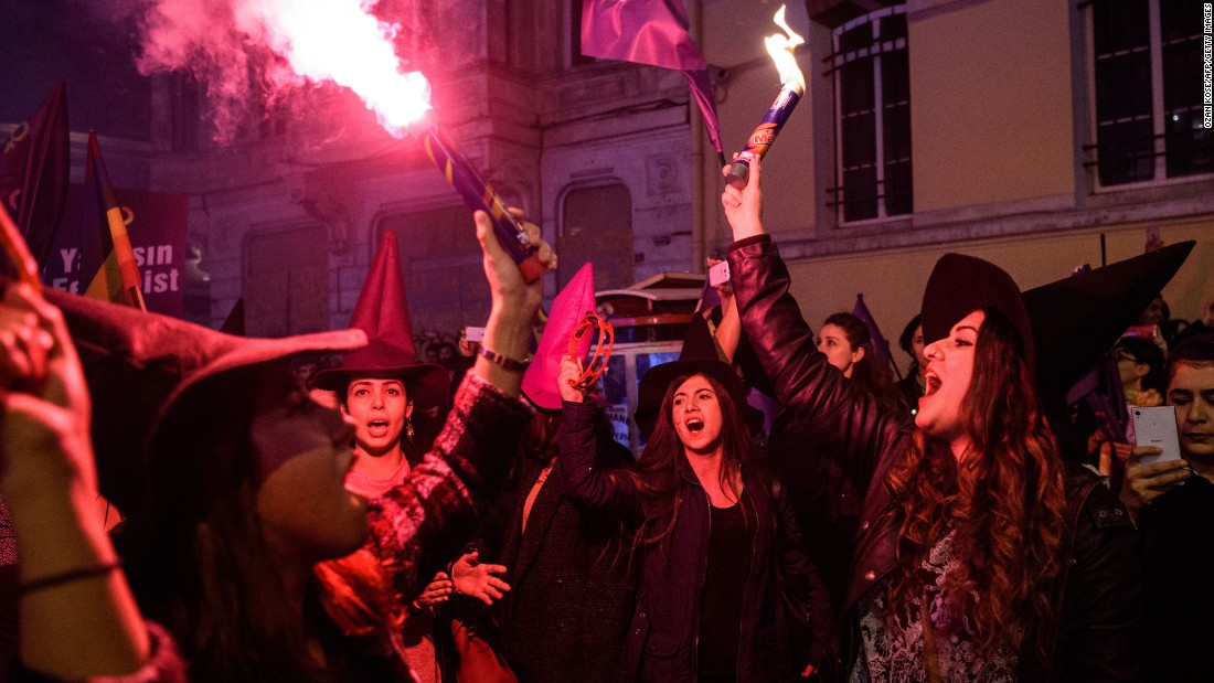 Women light flares and wave flags during a march in Istanbul on March 8.