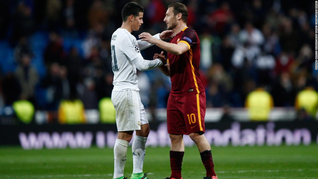 Goalscorer James Rodriguez of Real Madrid shakes hands with Francesco Totti of Roma -- who is playing in his 24th season -- following  the UEFA Champions League Round of 16 Second Leg match between Real Madrid and Roma at Estadio Santiago Bernabeu on March 8, 2016.