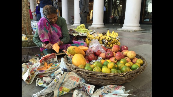 "INDIA: ""An elderly street vendor in New Delhi is seen talking on a smartphone. Home to a population of almost 1.3 billion people, India is already the world¹s third largest market for smartphones."" - CNN's Harmeet Singh @harmeetshahsingh."