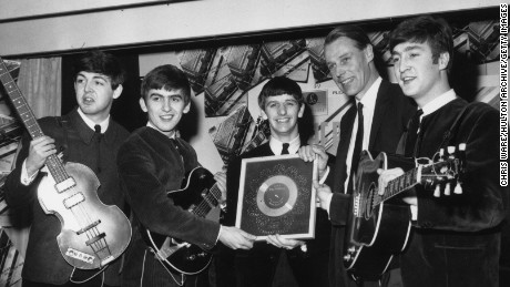George Martin pictured with the Beatles in 1963.
