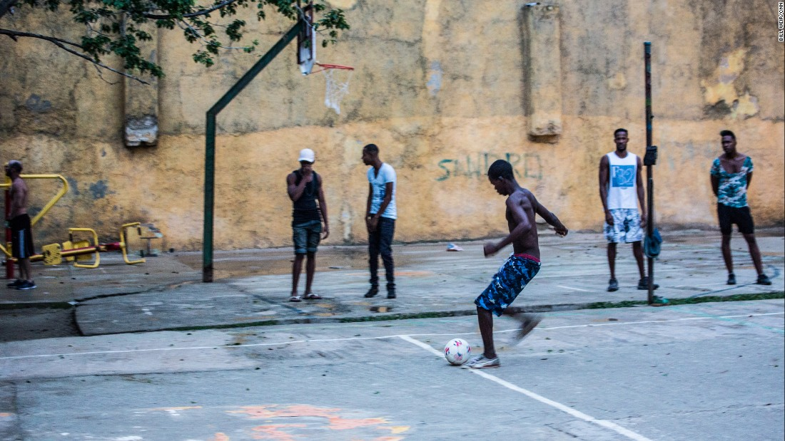 Local teens play soccer in the city after school. Cubans enjoy free education, as well as free health care. With a vast network of family doctors, they have lower infant mortality than Americans, and, according to some statistics, longer lifespans.