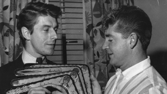 Derek Taylor (left) receives a set of  boomerangs during the group's 1964 Australian tour.