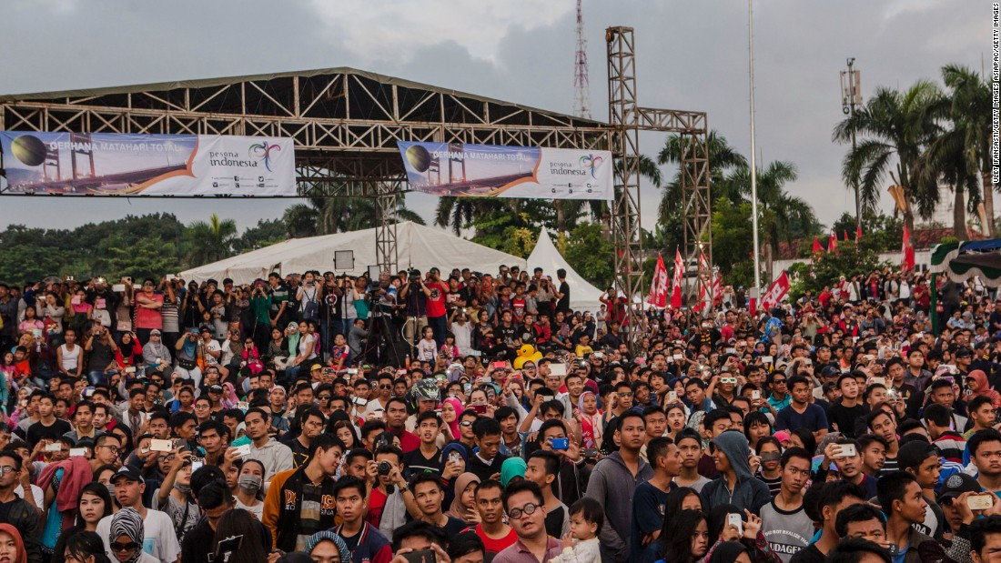 Many rose early to witness the occasion, like this crowd of people in Indonesia.