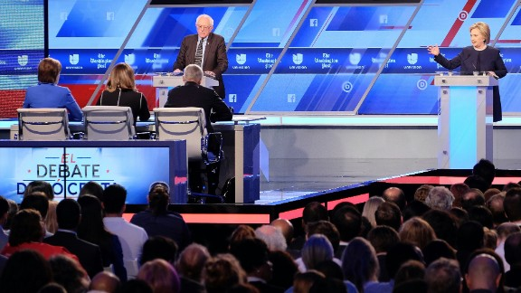 Democratic presidential candidates Hillary Clinton (R) and Bernie Sanders participate in the Univision and Washington Post democratic presidential debate at Miami Dade College in Miami, on March 9, 2016.