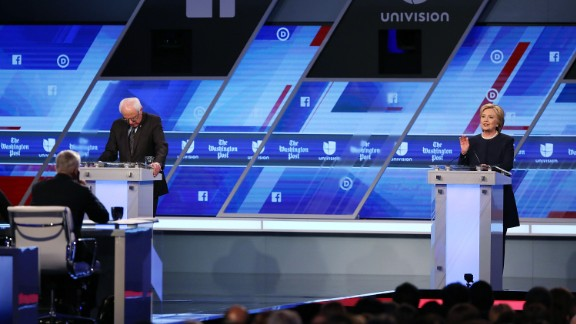MIAMI, FL - MARCH 09:  Democratic presidential candidate Senator Bernie Sanders (D-VT) and Democratic presidential candidate Hillary Clinton debate during the Univision News and Washington Post Democratic Presidential Primary Debate at the Miami Dade College