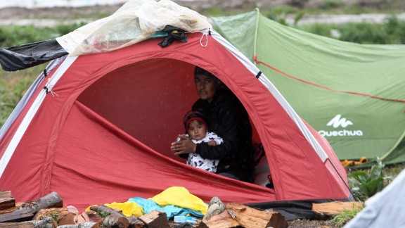 A  woman sits in a tent with her child near the Greek village of Idomeni the day after the Greek Macedonian border was closed to migrants.