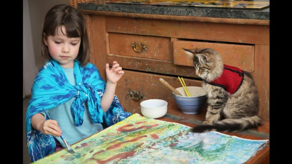 Whenever Iris is painting, which is her favorite activity, Thula is always close by.