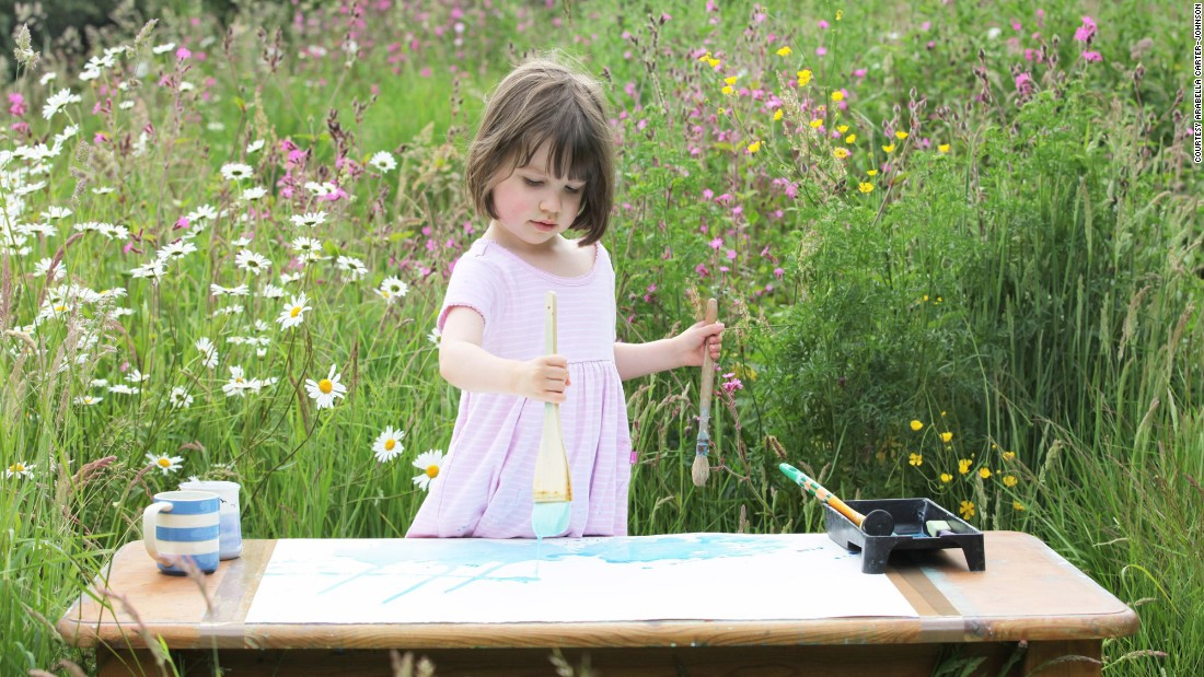 Iris creates her paintings using a variety of brushes and techniques with watercolors, like dabbing, flicking and dotting.