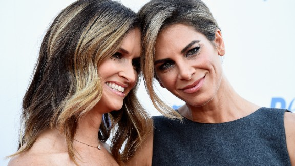 "Fitness guru Jillian Michaels, right, proposed to girlfriend Heidi Rhoades on the Tuesday season finale of her E! reality show ""Just Jillian."" Rhoades said yes after watching a fake movie trailer about their own love story."