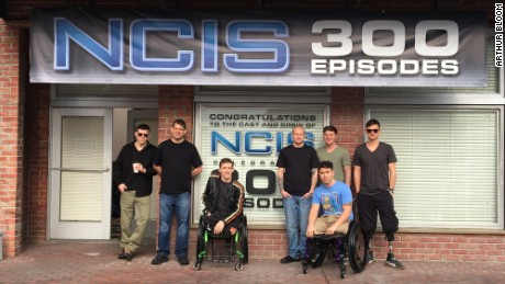"MusiCorps' Arthur Bloom, Nathan Kalwicki, Tim Donley, Will Cook, Josh Cawthorn, Marcus Dandrea and Johnathon Mullen on the ""NCIS"" set."