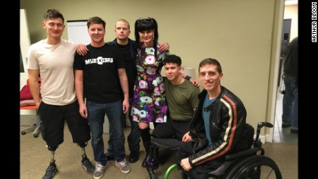 """NCIS"" cast member Pauley Perrette, center, poses with the MusiCorps members."