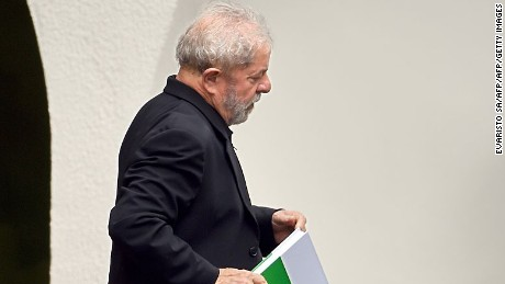 "Former Brazilian President Luiz Inacio Lula da Silva leaves after having a breakfast meeting with senators from several parties at the residence of Senate President Renan Calheiros, in Brasilia, on March 9, 2016. Lula da Silva is facing allegations of taking bribes and laundering money from Petrobras-connected companies. On March 4 he was briefly detained for questioning over alleged ""favours"" received from corrupt construction companies implicated in a kickback scheme, prosecutors said. Lula da Silva was targeted as part of the Operation Car Wash investigation into a sprawling embezzlement and bribery conspiracy centred on the state oil giant Petrobras.  AFP PHOTO/EVARISTO SA / AFP / EVARISTO SA        (Photo credit should read EVARISTO SA/AFP/Getty Images)"