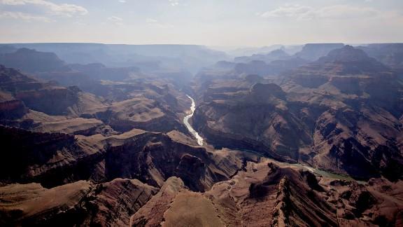 The Colorado River runs through Grand Canyon National Park in this aerial photograph taken above Grand Canyon, Arizona.